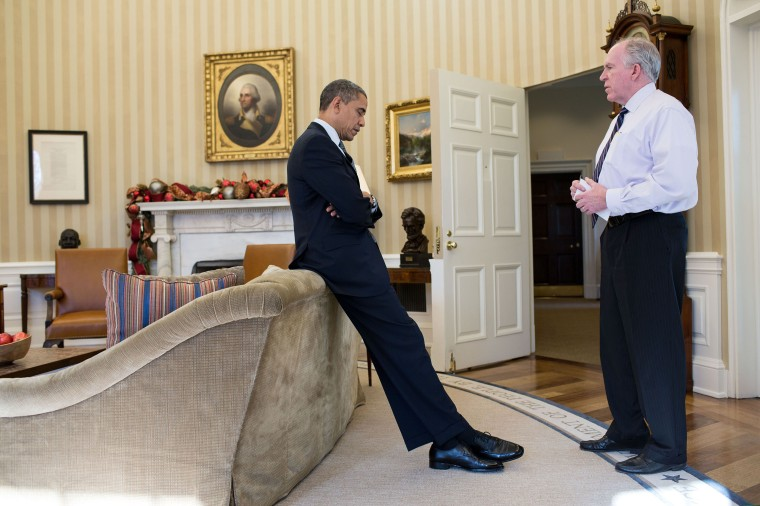 President Obama reacts as John Brennan briefs him on the details of the shootings at Sandy Hook Elementary School on Dec. 14, 2012.
