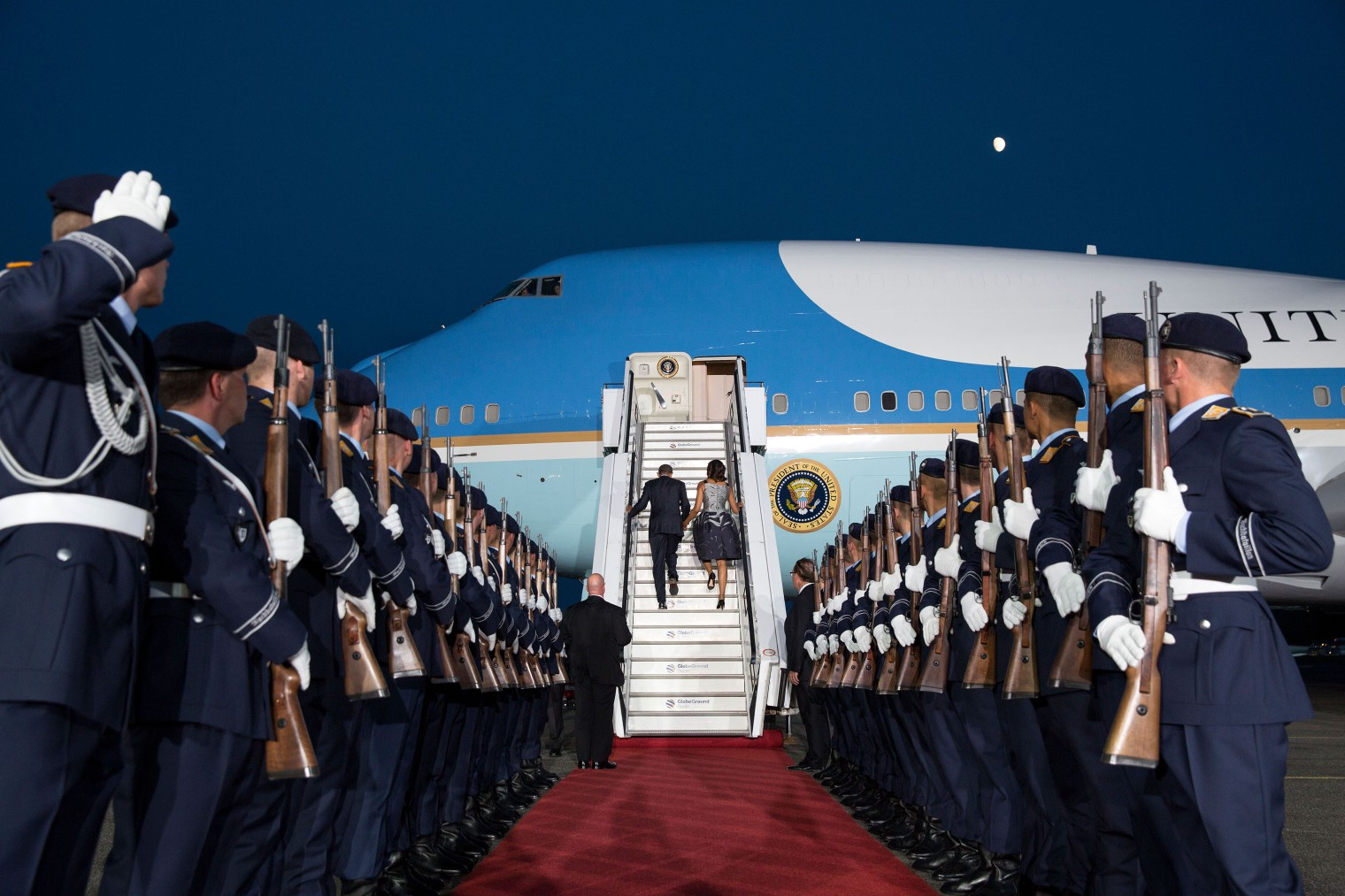 President Barack Obama and First Lady Michelle Obama board Air Force One as they depart Berlin on June 19, 2013..