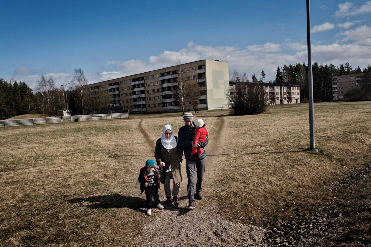 """<span class=""""credit"""">Syrian refugees Taima Abzali and her husband Muhanned Abzali, and their six month old daughter, Heln, and son Wael, walk near their apartment complex on their first full day in Estonia, April 21, 2017. (Credit: Lynsey Addario for Time Magazine)</span><span class=""""caption"""">Syrian refugees Taima Abzali and her husband Muhanned Abzali, and their six month old daughter, Heln, and son Wael, walk near their apartment complex on their first full day in Estonia, April 21, 2017. (Credit: Lynsey Addario for Time Magazine)</span>"""