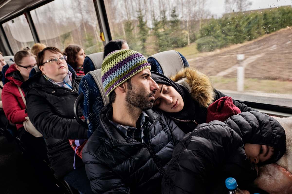"""<span class=""""credit"""">Syrian refugees Taima Abzali and her husband Muhanned Abzali, and their six month old daughter, Heln, and son Wael, take the bus in the early morning in the sleet and snow as they make their way to their orientation with IOM on their second full day in Estonia, April 21, 2017. The family is struggling to cope with the weather and the stark difference in culture in Estonia. (Credit: Lynsey Addario for Time Magazine)</span><span class=""""caption"""">Syrian refugees Taima Abzali and her husband Muhanned Abzali, and their six month old daughter, Heln, and son Wael, take the bus in the early morning in the sleet and snow as they make their way to their orientation with IOM on their second full day in Estonia, April 21, 2017. The family is struggling to cope with the weather and the stark difference in culture in Estonia. (Credit: Lynsey Addario for Time Magazine)</span>"""