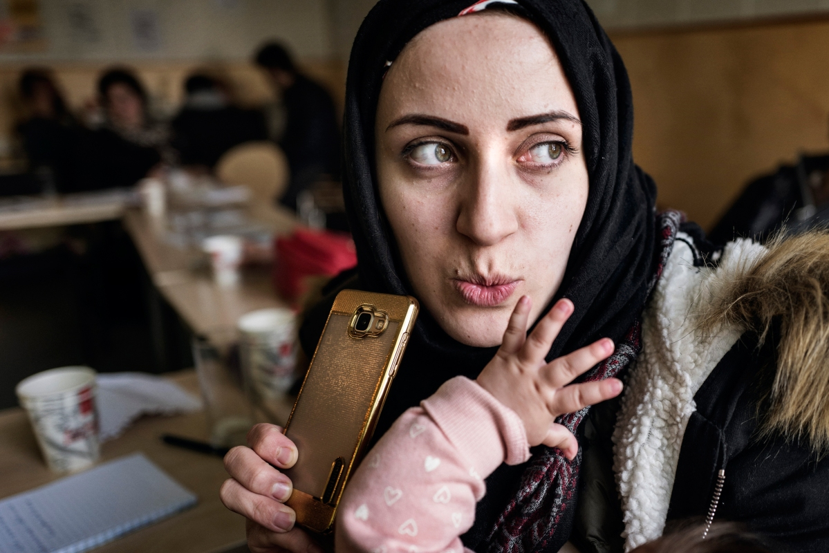 """<span class=""""credit"""">Syrian refugee Taima Abzali records Whats app messages in response to her loved ones who have called and messaged about how she and the family are doing, during a break at an orientation for new Syrian families given by IOM on their second full day in Estonia, April 21, 2017. (Credit: Lynsey Addario for Time Magazine)</span><span class=""""caption"""">Syrian refugee Taima Abzali records Whats app messages in response to her loved ones who have called and messaged about how she and the family are doing, during a break at an orientation for new Syrian families given by IOM on their second full day in Estonia, April 21, 2017. (Credit: Lynsey Addario for Time Magazine)</span>"""