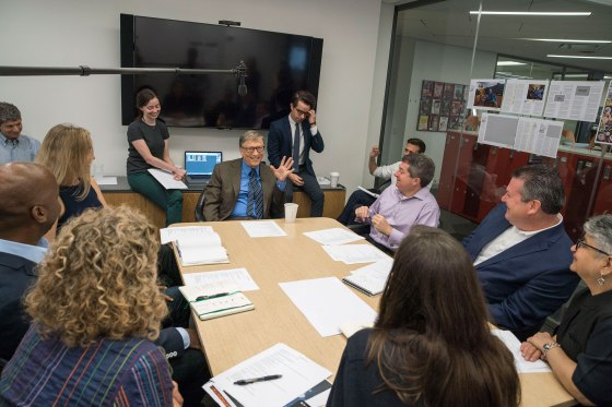 Bill Gates, the first guest editor in TIME's 94-year history, meets with the publication's staff.