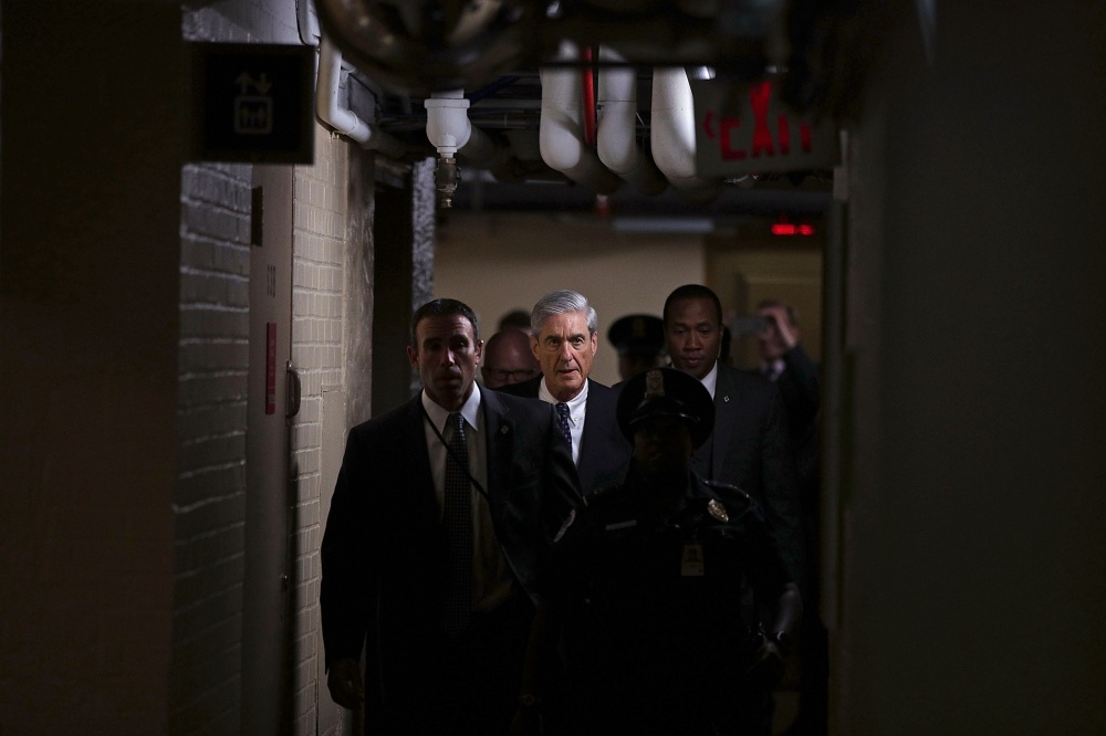 Mueller leaves a closed meeting on June 21 with the Senate Judiciary Committee about Comey's firing