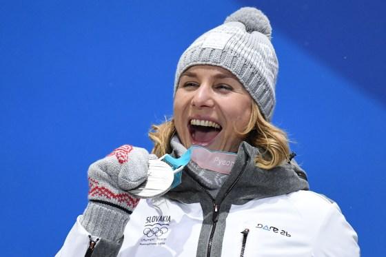 Slovakia's silver medallist Anastasiya Kuzmina poses on the podium during the medal ceremony for the biathlon women's 10km pursuit on Feb. 13, 2018.