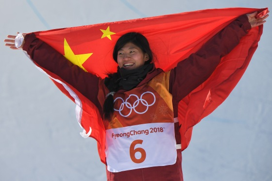 Silver medallist China's Liu Jiayu celebrates during the victory ceremony after the women's snowboard halfpipe final on Feb. 13, 2018.