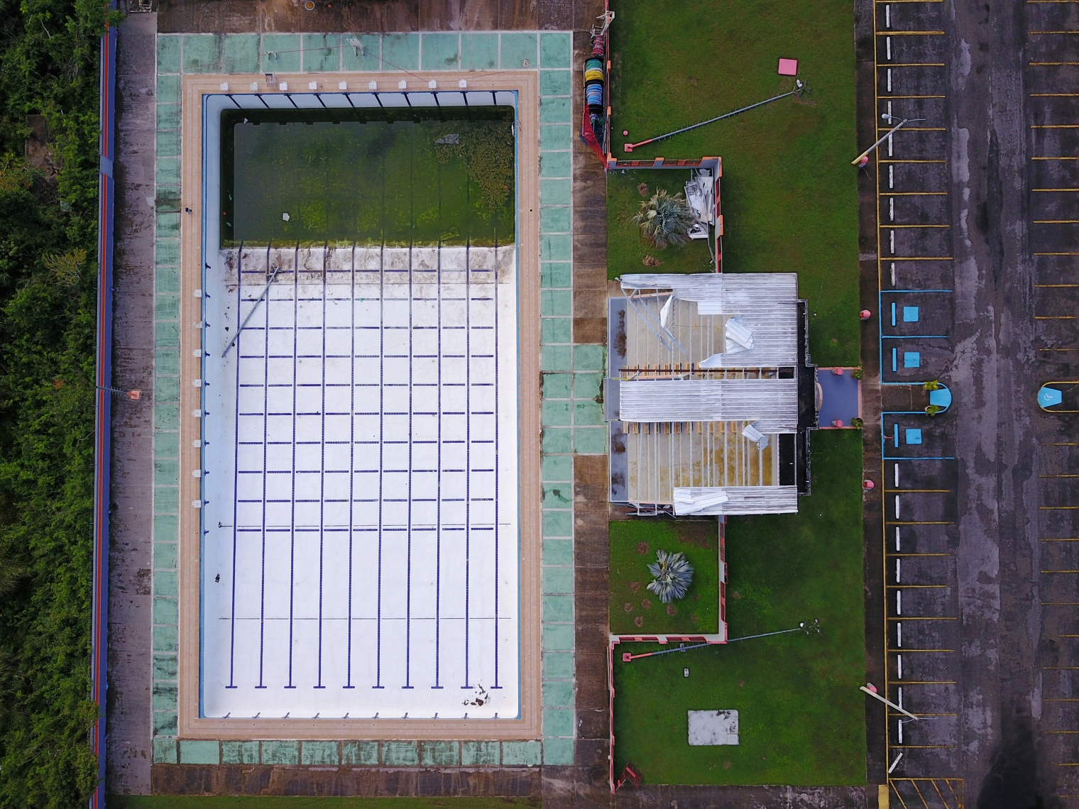 A pool is left in disrepair at a sports facility in Vega Baja