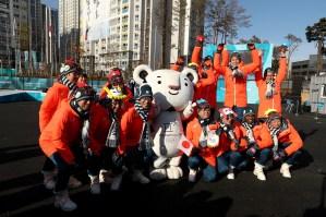 Members of the Japan team pose with mascot Soohorang