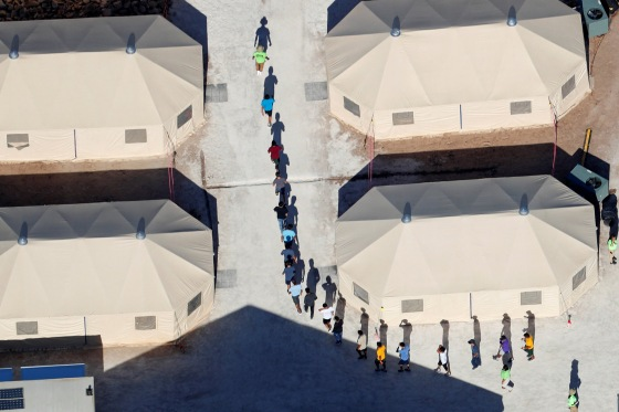 Immigrant children walk in single file