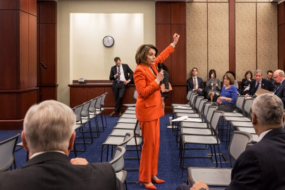 Pelosi addresses members of her caucus during a meeting in February