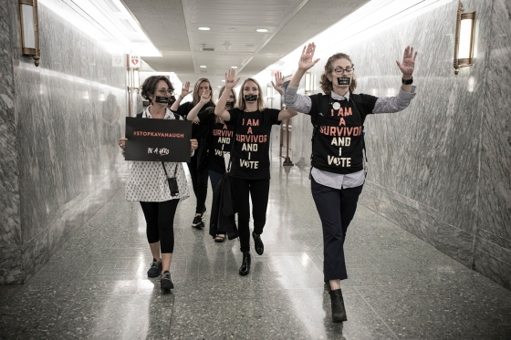 Women protested Kavanaugh's nomination inside the Dirksen Senate Office Building in late September