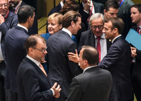 Kurz, center, speaks to European Commission President Jean-Claude Juncker and French President Emmanuel Macron at the start of a European Council summit in Brussels in October