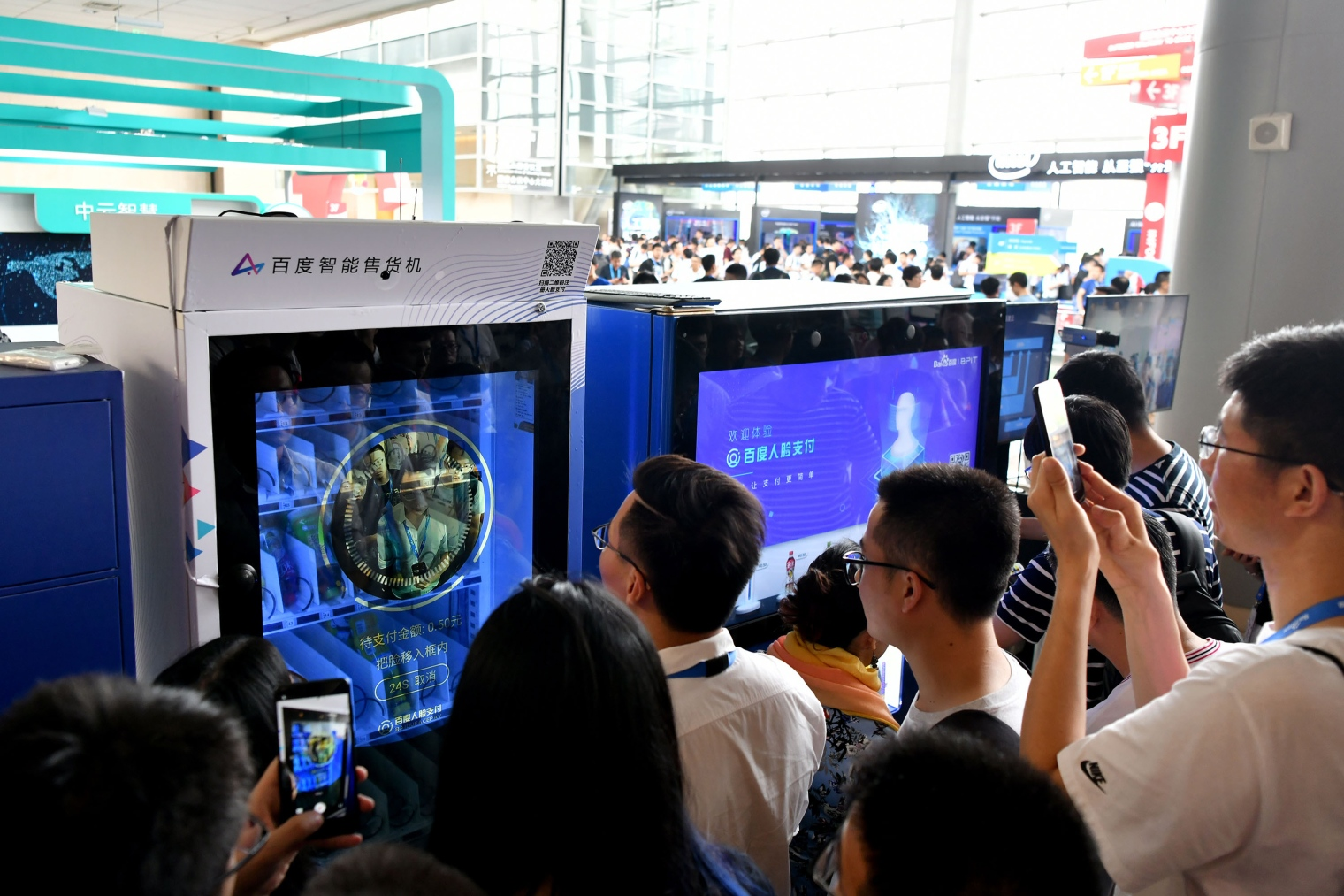 People experience the face recognition payment system during Baidu Create 2018 at China National Convention Center in Beijing, July 4, 2018.
