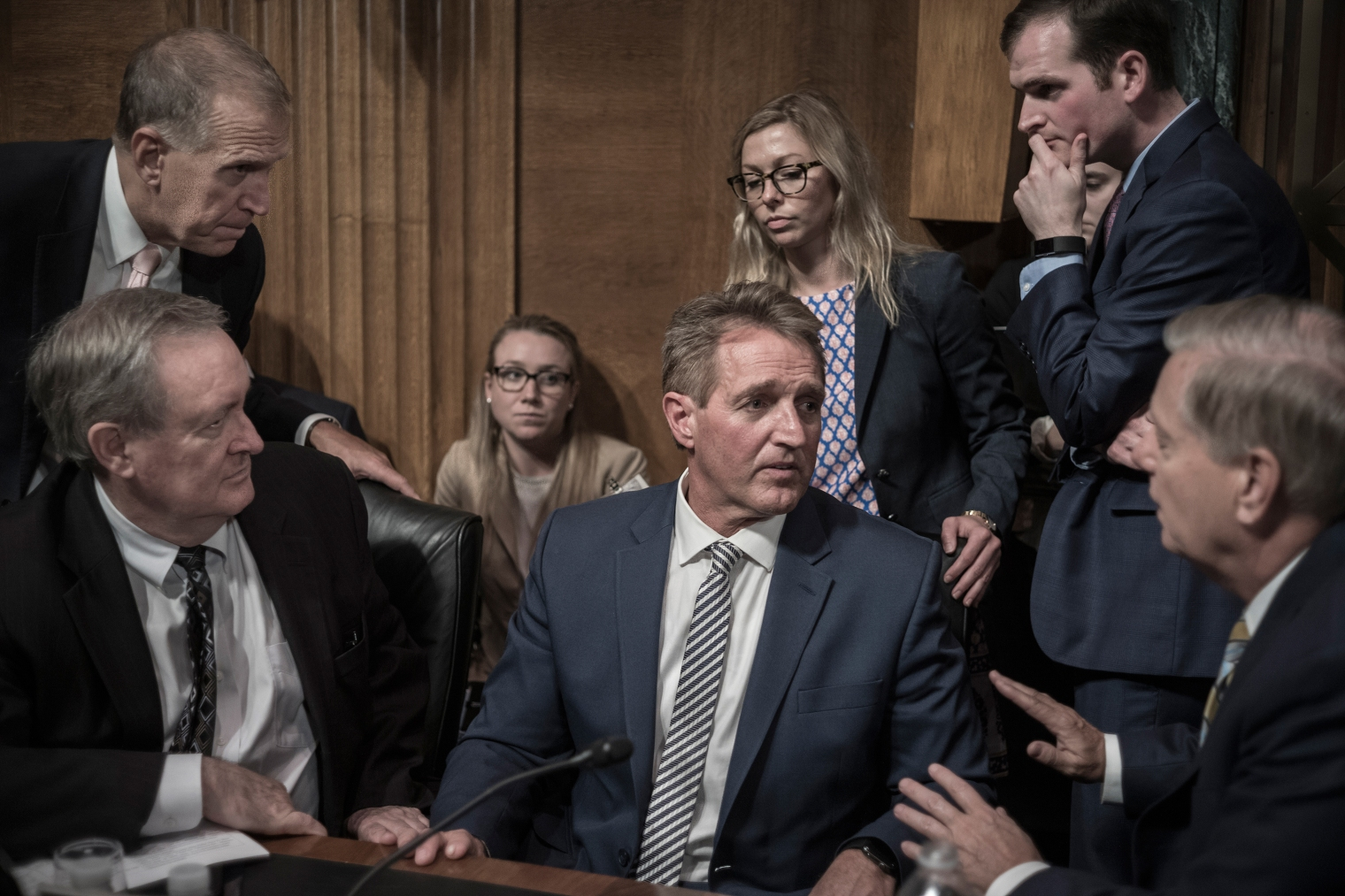 Jeff Flake, center, listens to fellow GOP Senator Lindsey Graham, right, on Sept. 28, moments after Flake called for a delay in Brett Kavanaugh's Supreme Court confirmation