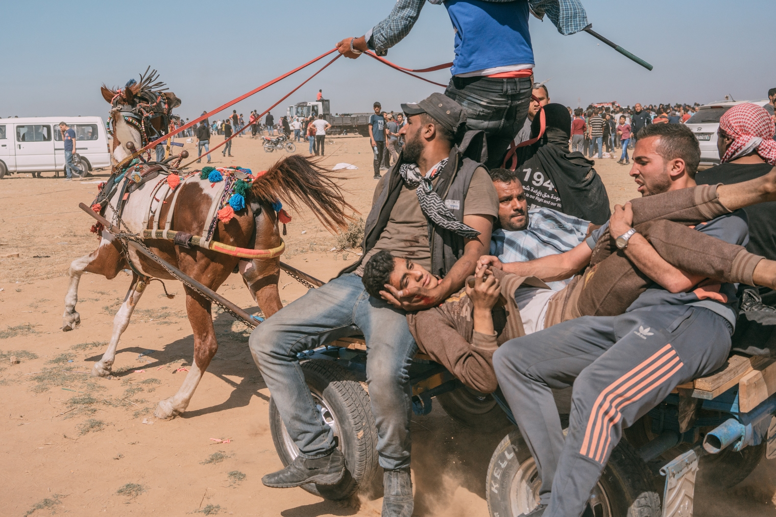 As the U.S. opened a new embassy in Jerusalem on May 14, violence erupted just miles away at the Gaza border, where Israeli soldiers clashed with Palestinian protesters like this injured man, who was evacuated by horse cart.