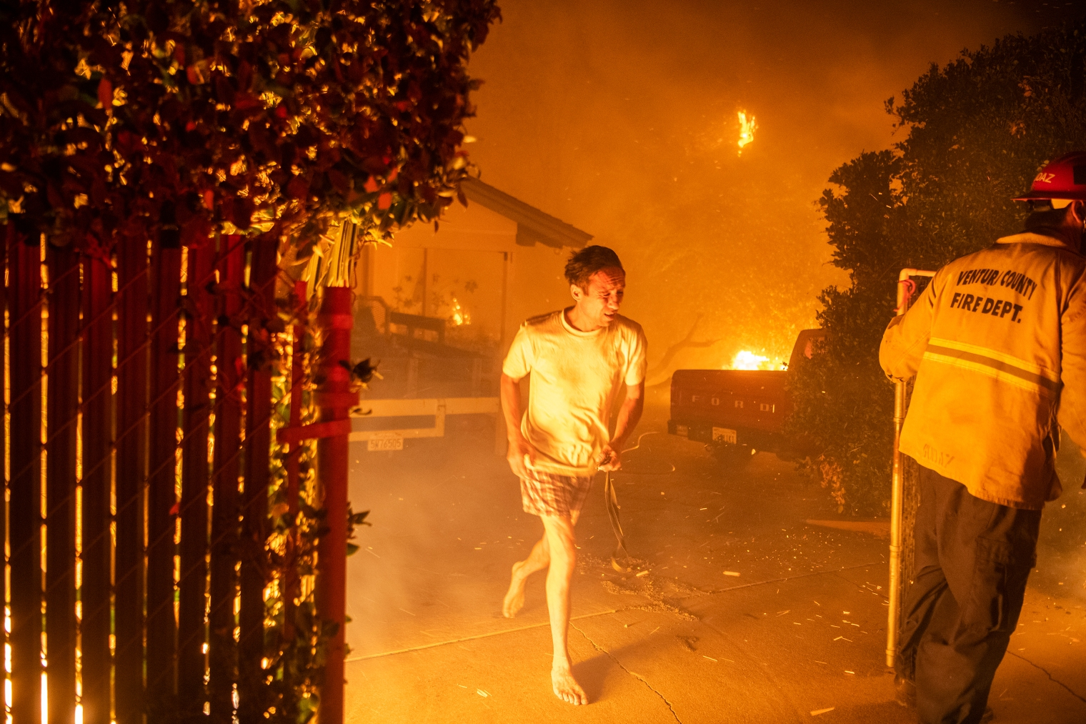 A resident flees his home in Thousand Oaks, Calif. during a wildfire