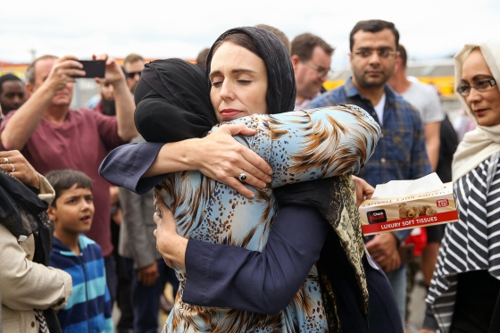 New Zealand Prime Minister Jacinda Ardern hugs a worshipper at Kilbirnie Mosque in Wellington two days after theattacks