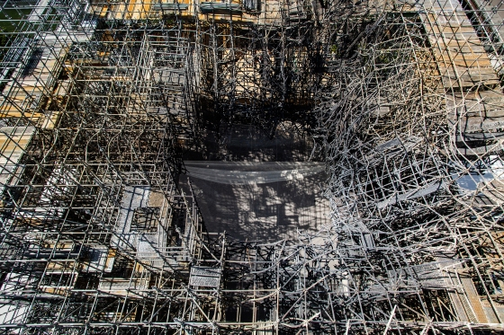 Burnt scaffolding, as seen from above in late July, will be removed.